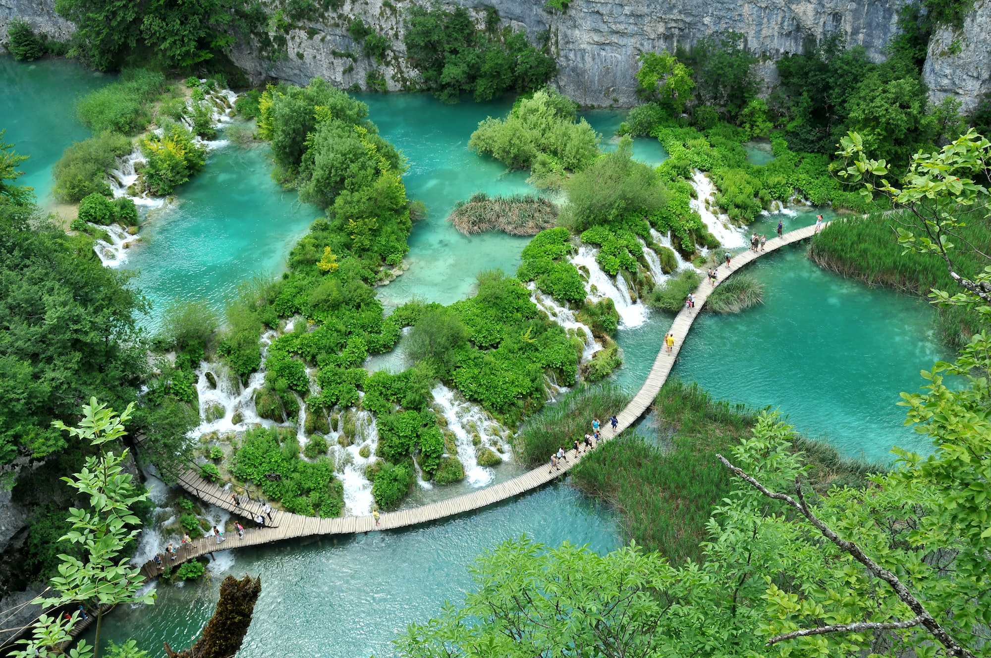 Plitviče Lakes National Park consists of 16 natural lakes joined by waterfalls that extend into limestone canyons.