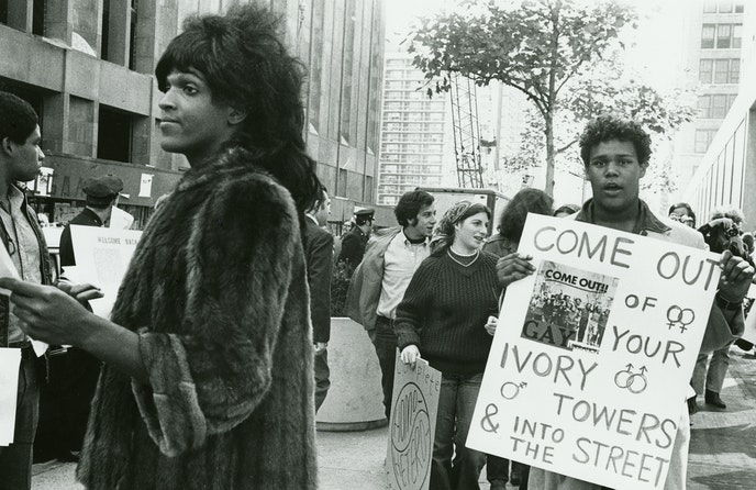 Marsha P. Johnson hands out flyers in support of gay students at NYU in 1970. (Image by Diana Davies)