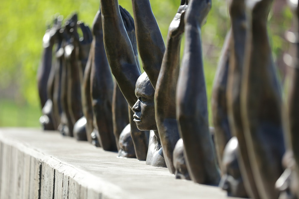 "The Hank Willis Thomas sculpture, ""Raise Up,"" is one of many pieces by African American artists at the memorial."