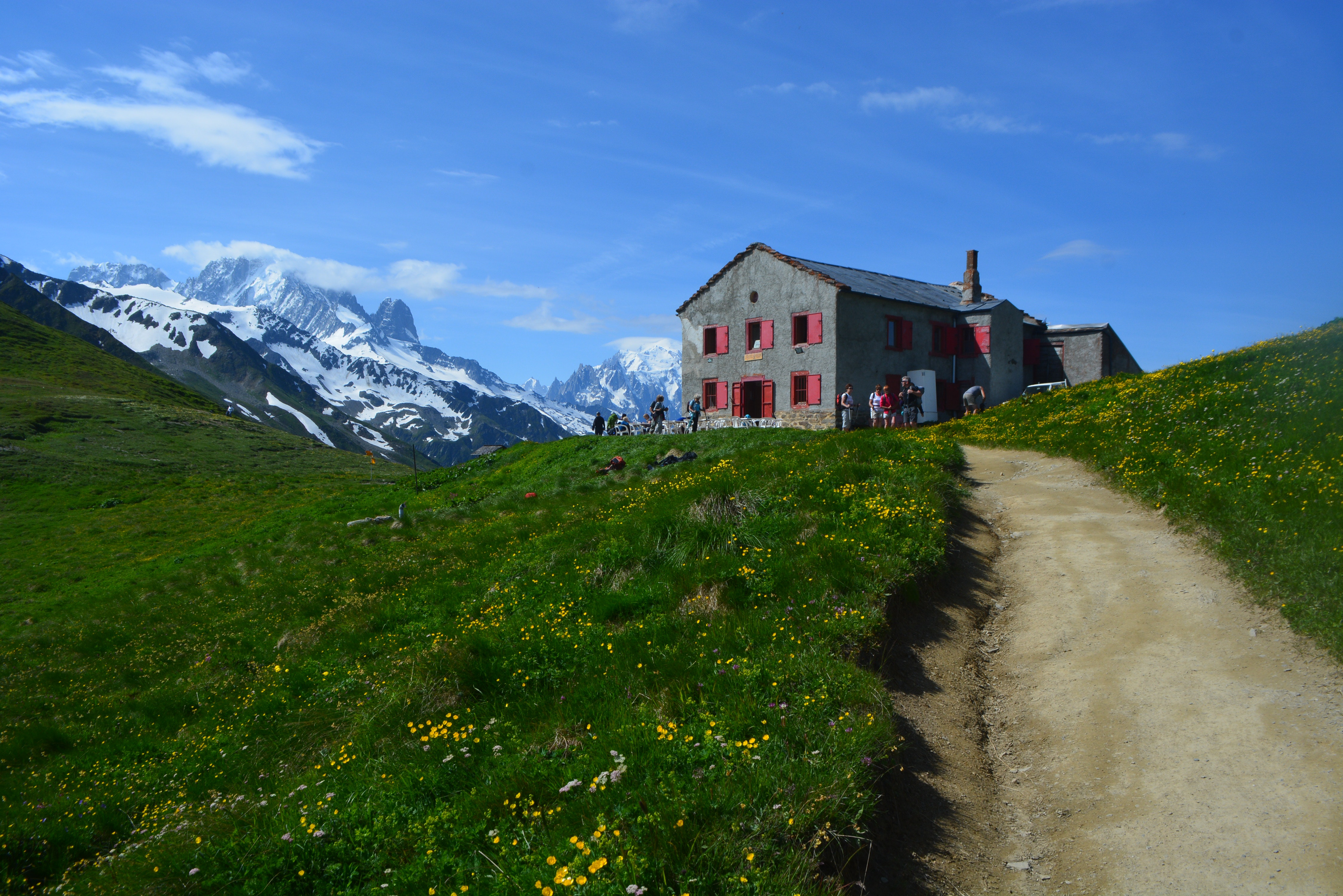 Refuges high in the Alps allow hikers to sleep under roofs, eat warm meals, and meet other travelers during their trek.