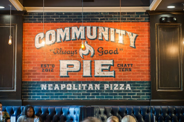 People nosh on Neapolitan-style pizza at Community Pie in Chattanooga, TN.