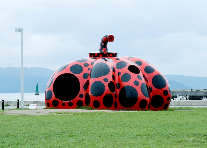 """Before you can see Yayoi Kusama's iconic """"Yellow Pumpkin"""" sculpture near the Benesse House Museum on Naoshima, you'll pass by her """"Red Pumpkin"""" when you step off the ferry at the island's Miyanoura dock."""
