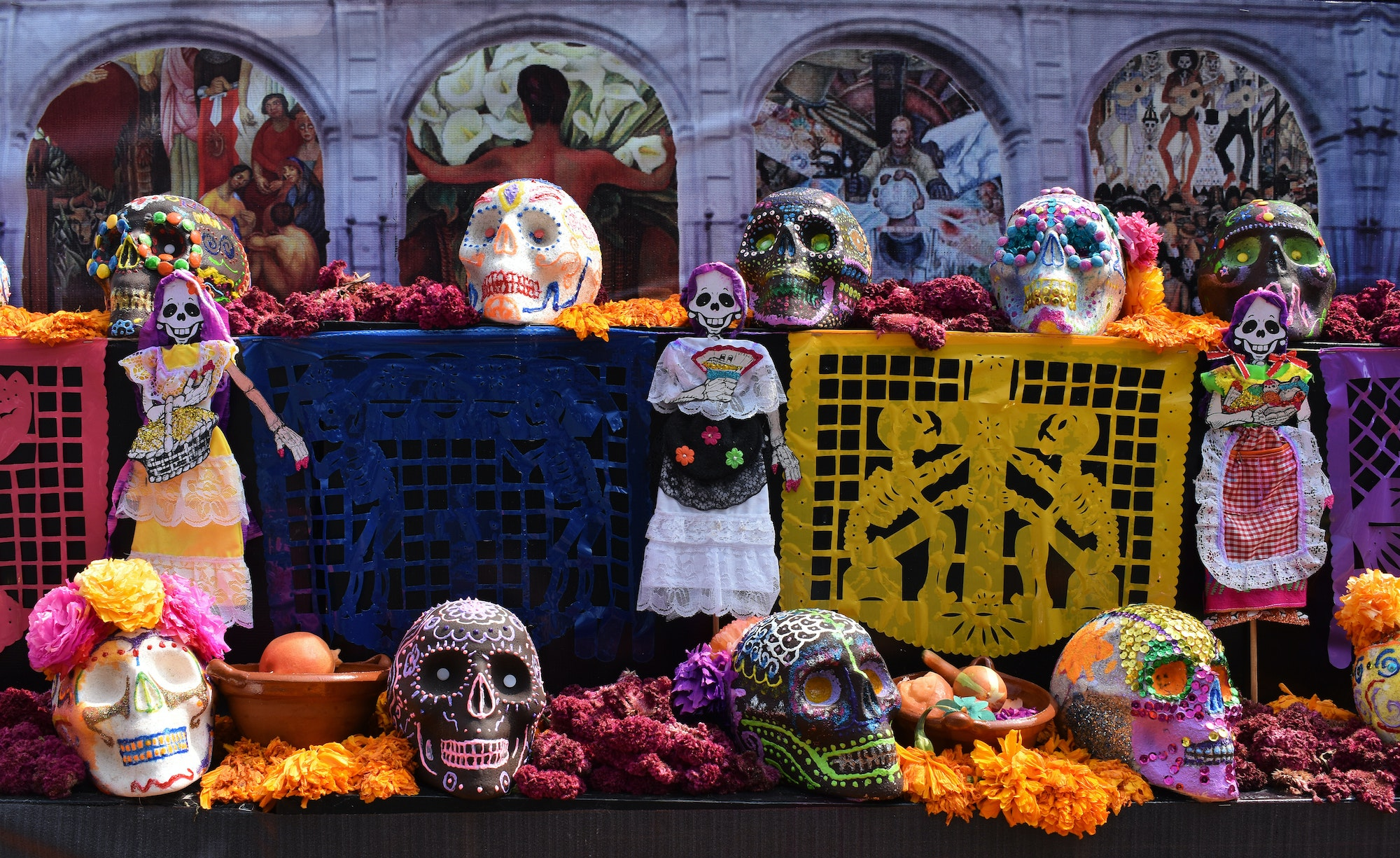 """Modern day """"ofrendas"""" typically include sugar skulls, papel picados, and marigolds."""
