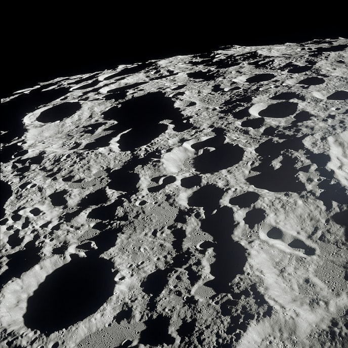 """Astronaut Michael Collins, who was part of the """"Apollo 11"""" crew with Armstrong and Aldrin—but remained in the command module throughout the mission—photographed the moon's far side while in lunar orbit."""