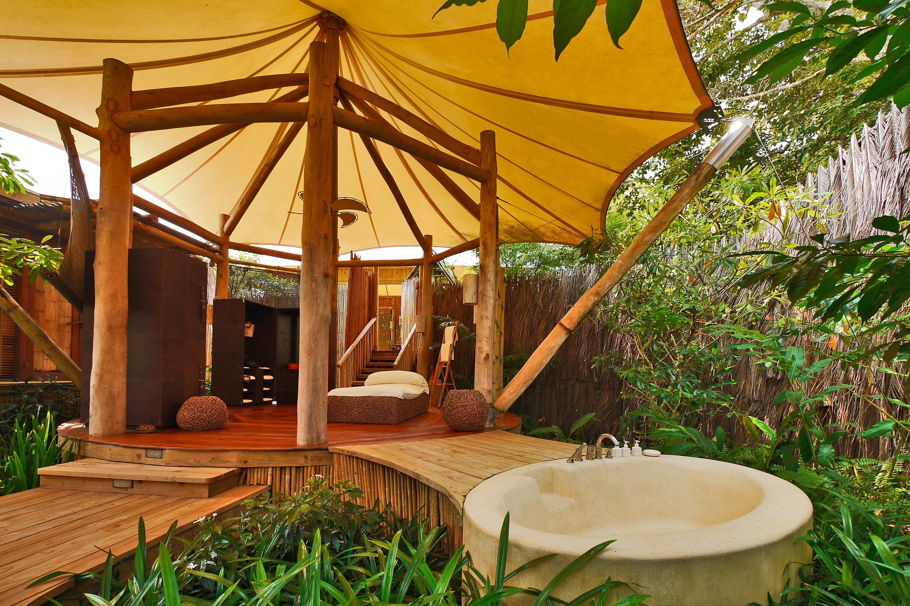Unplug and unwind in one of Soneva Kiri's pavilion-style bathrooms.