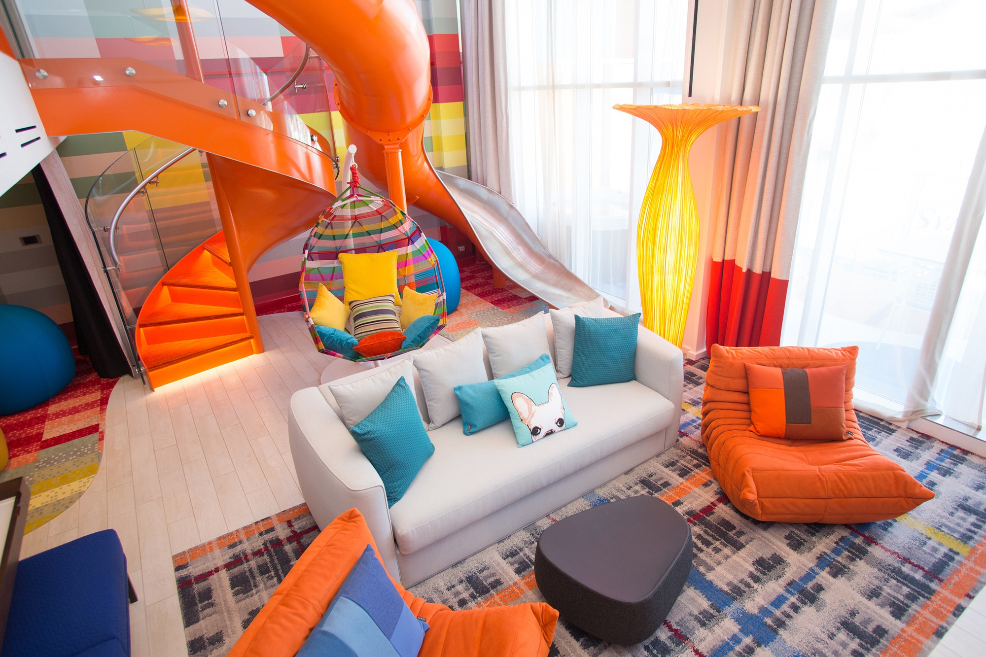 The two-floor Ultimate Family Suite features an indoor slide, an air hockey table, and a giant Lego wall.