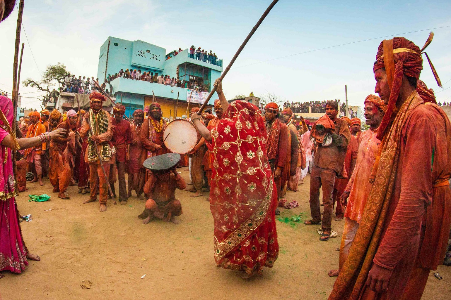 The unique mythology-inspired Lathmaar Holi tradition sees townswomen in Barsana and Nandgaon pretend to hit the townsmen with lathis, or sticks.