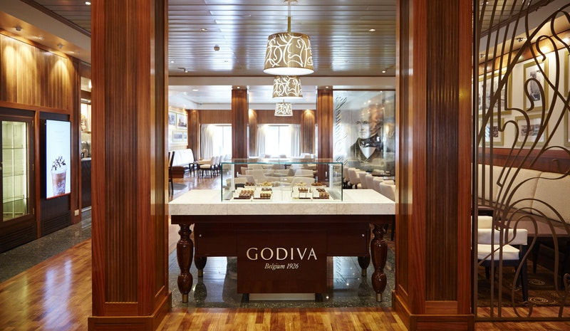 Sir Samuel's coffee bar now carries Godiva.