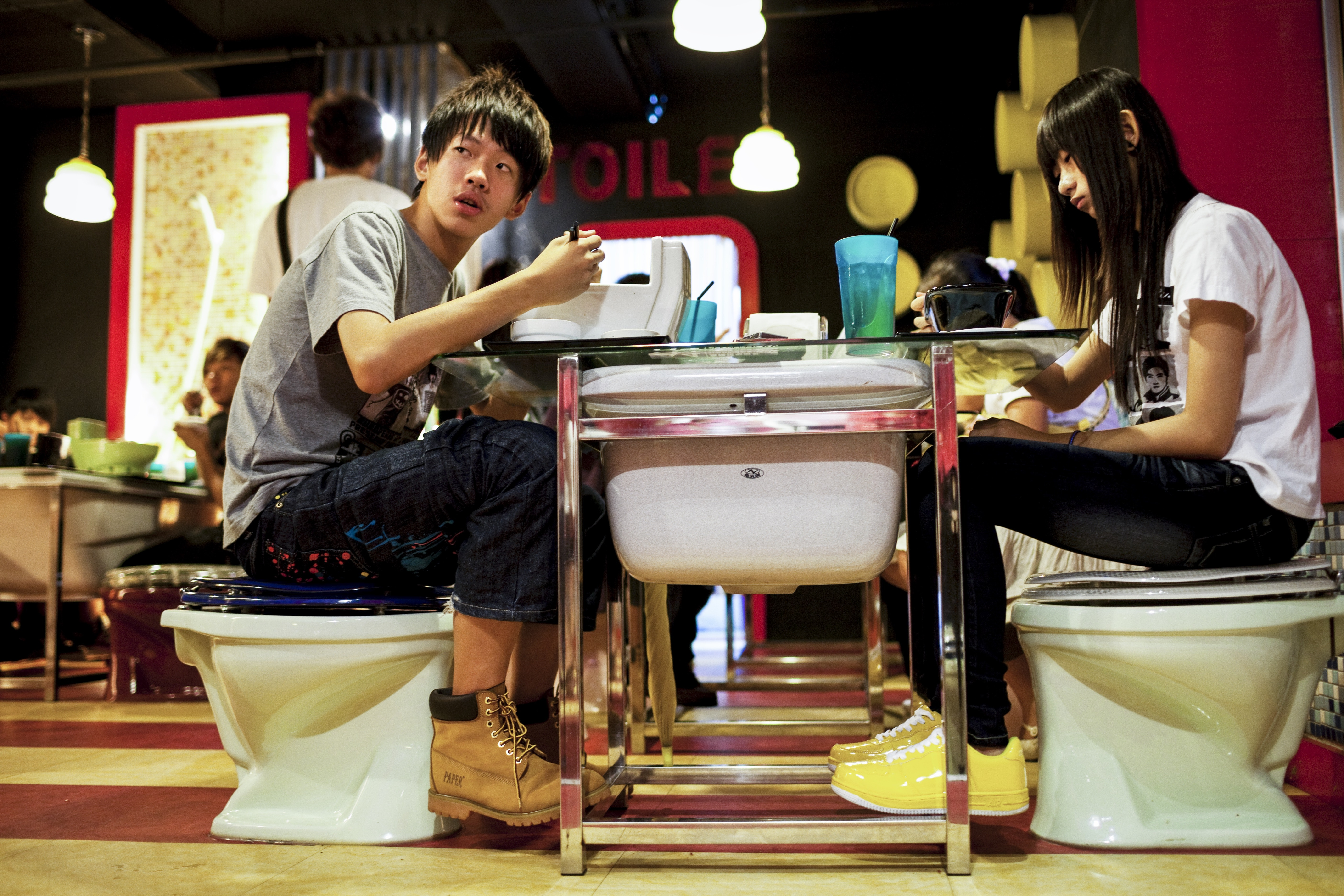 At Modern Toilet, a national chain in Taiwan, diners eat out of urinals and toilet bowls, all while sitting on the pot.