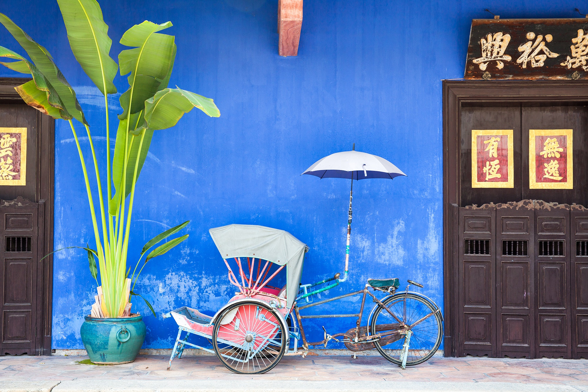 An old rickshaw tricycle near Cheong Fatt Tze Mansion in George Town on Penang Island