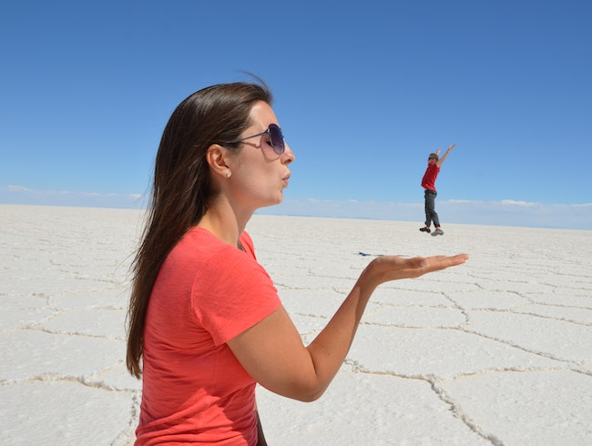 Take a funny perspective photo in Bolivia's salt flats