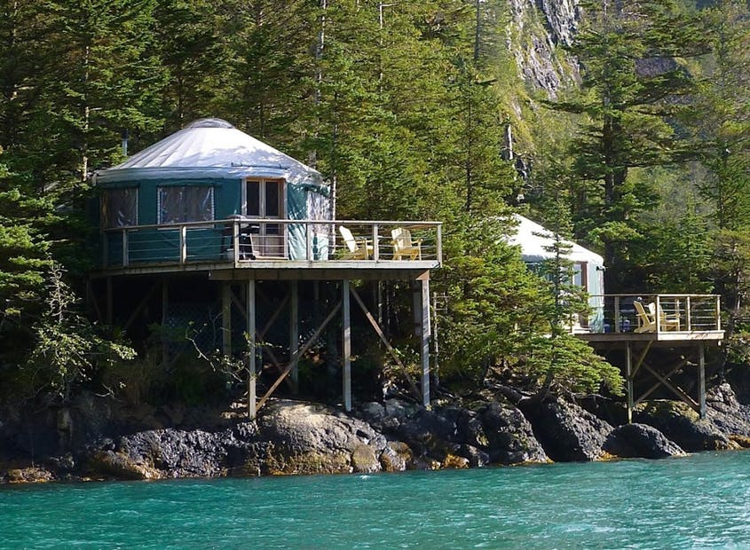 One way to really get off the grid is in the Orca Island Cabins, ecofriendly yurts on a private island in southern Alaska.