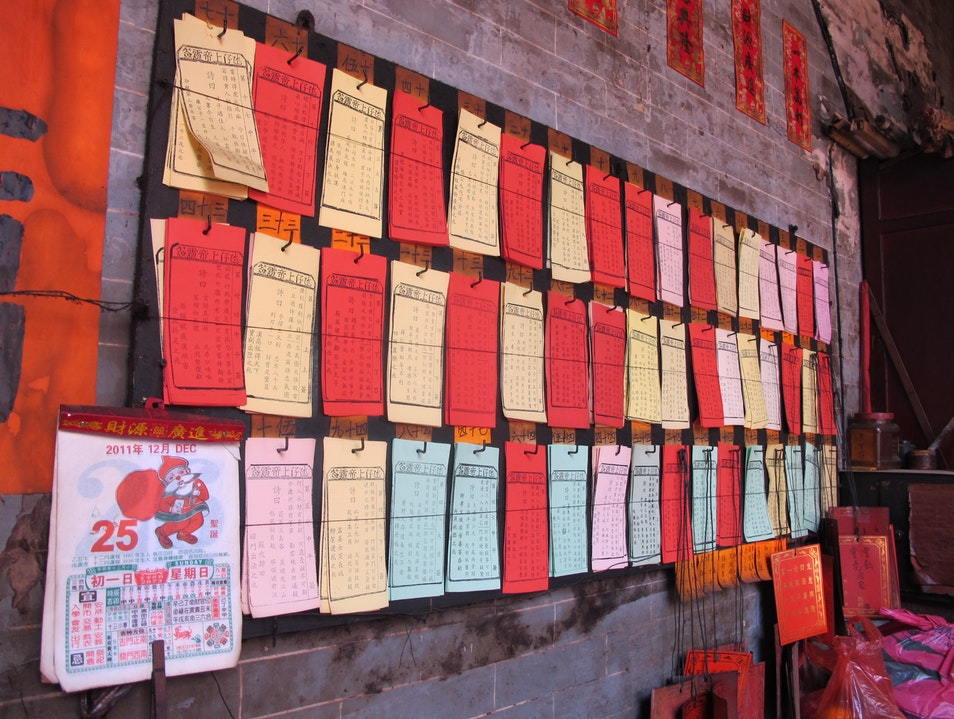 Old school calendars and fortune slips on the wall Taipa  Macau