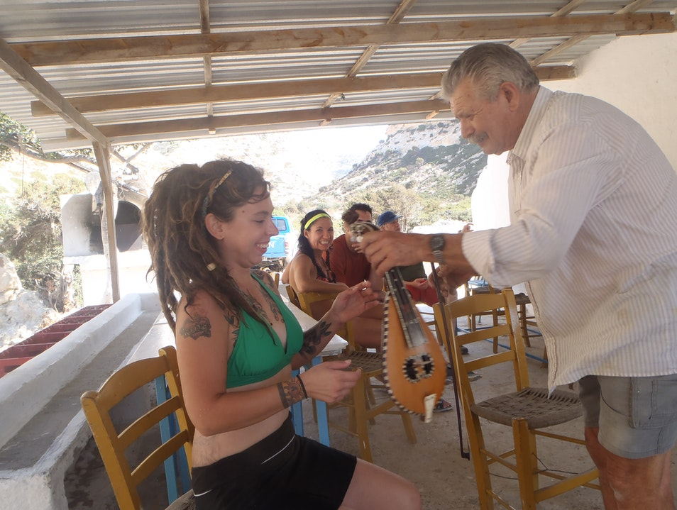 Learning to Play the Lyra at Vathi Beach Heraklion  Greece