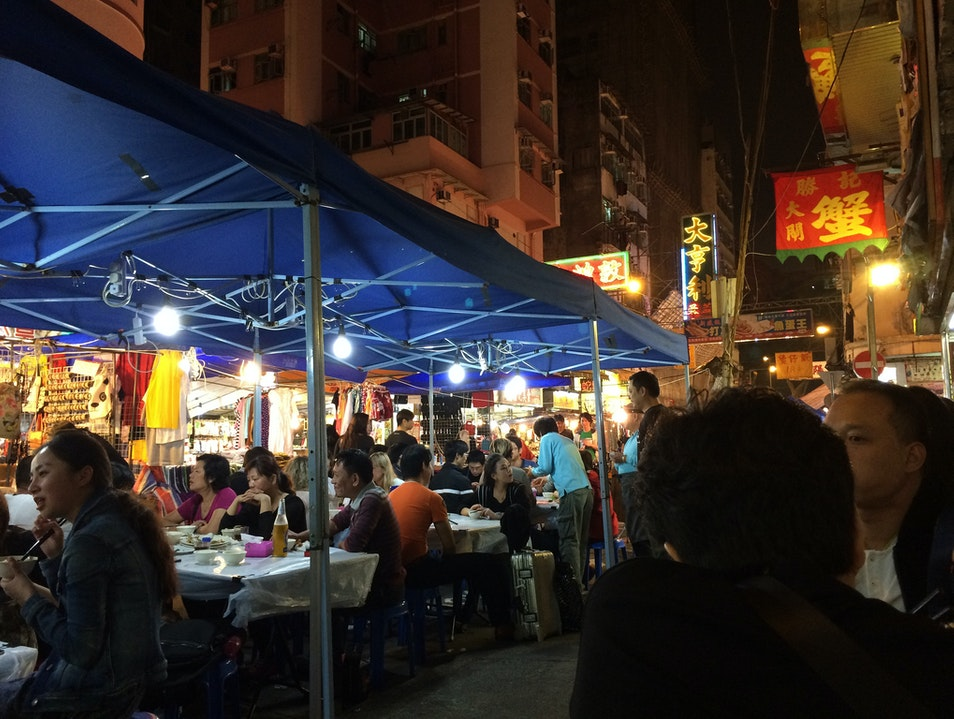 """The Place with the Yellow Sign,"" a restaurant in the Temple Street Night Market Hong Kong  Hong Kong"