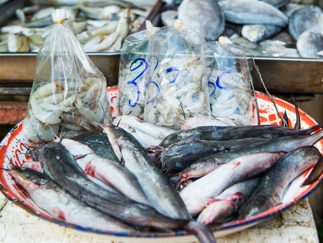 Going After the Catch, Monday Market, Saldan Village, Koh Lanta, Krabi Province, Thailand.