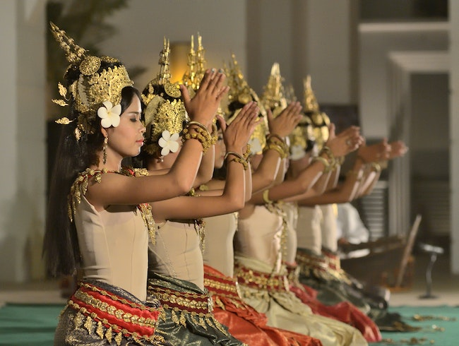 Admire the stylized moves of the Apsara dancers