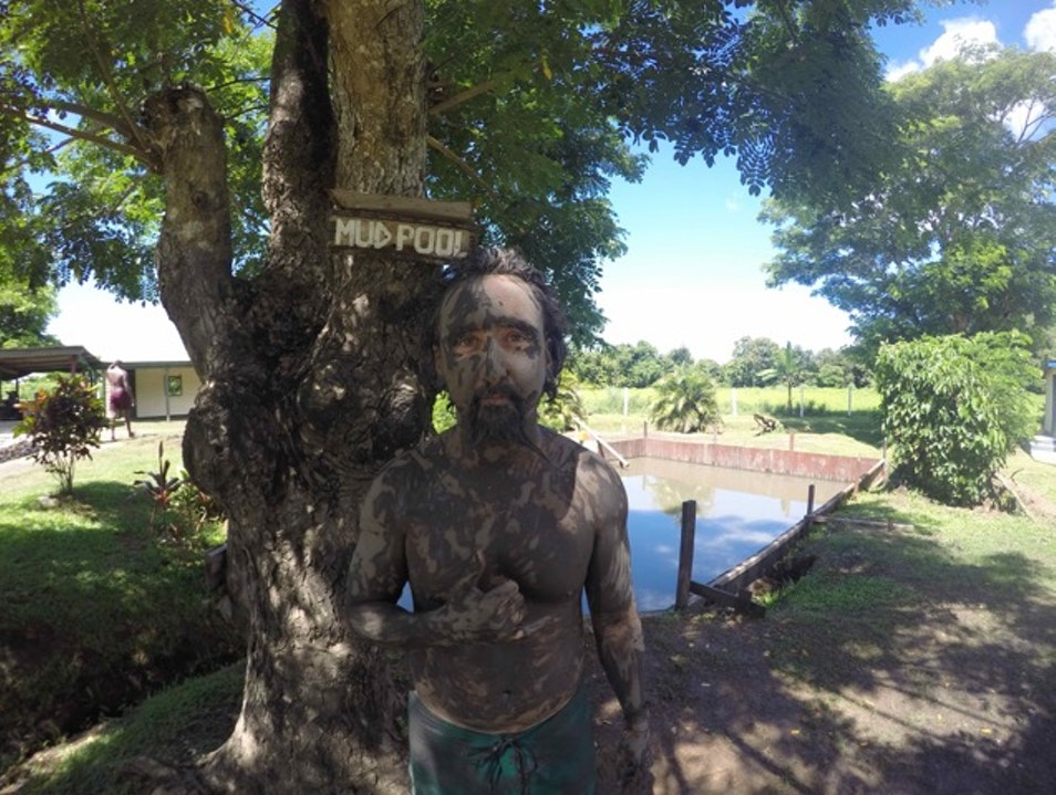 Cover your body in mud and soak in hot springs