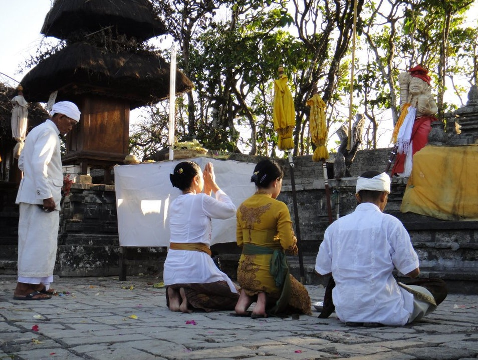 Locals praying Kuta  Indonesia