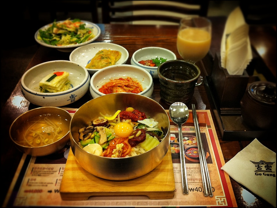 Rice in a brass bowl with toppings and sides galore Seoul  South Korea