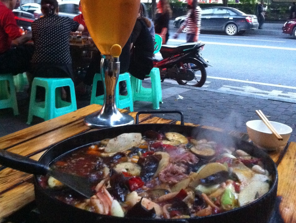 'Hot pot' and cold pilsner at a local street eatery Chongqing  China
