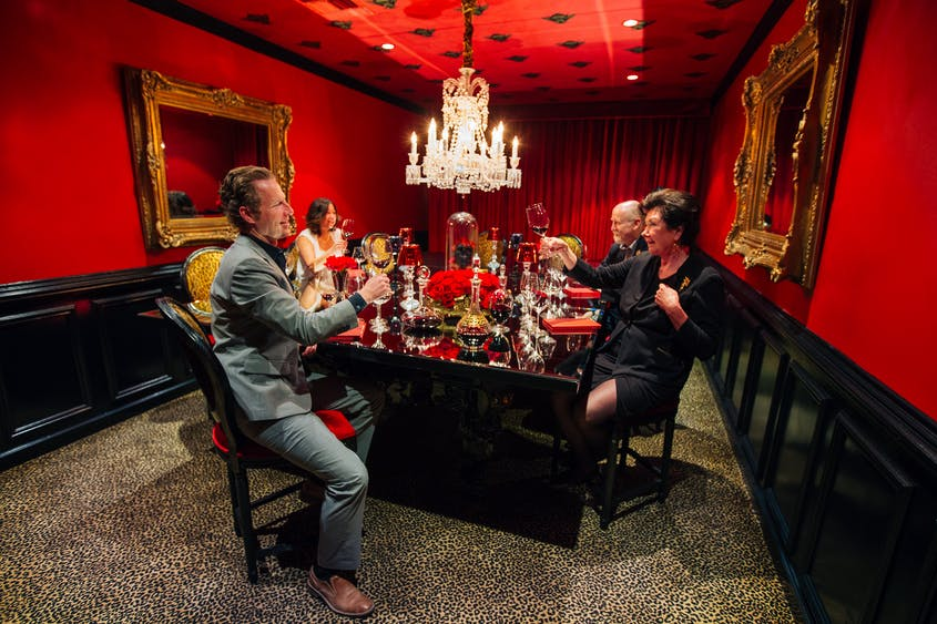 The bright red walls of Raymond Vineyards's private tasting room make for fun photos.