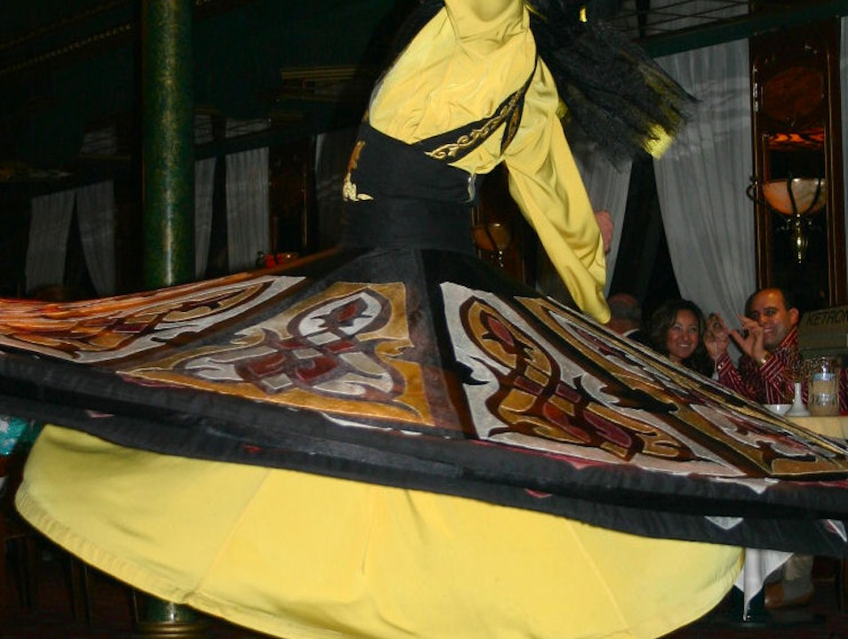 Whirling Dervish performing while sailing on the Nile Cairo  Egypt
