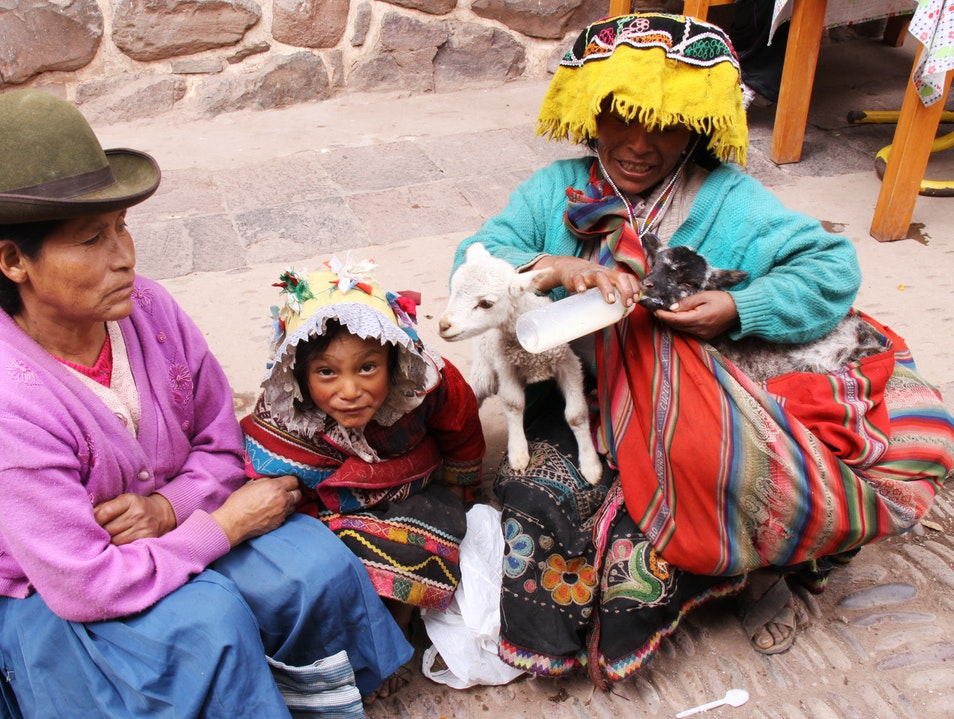 Give locals some Sole to take thier picture Pisac  Peru