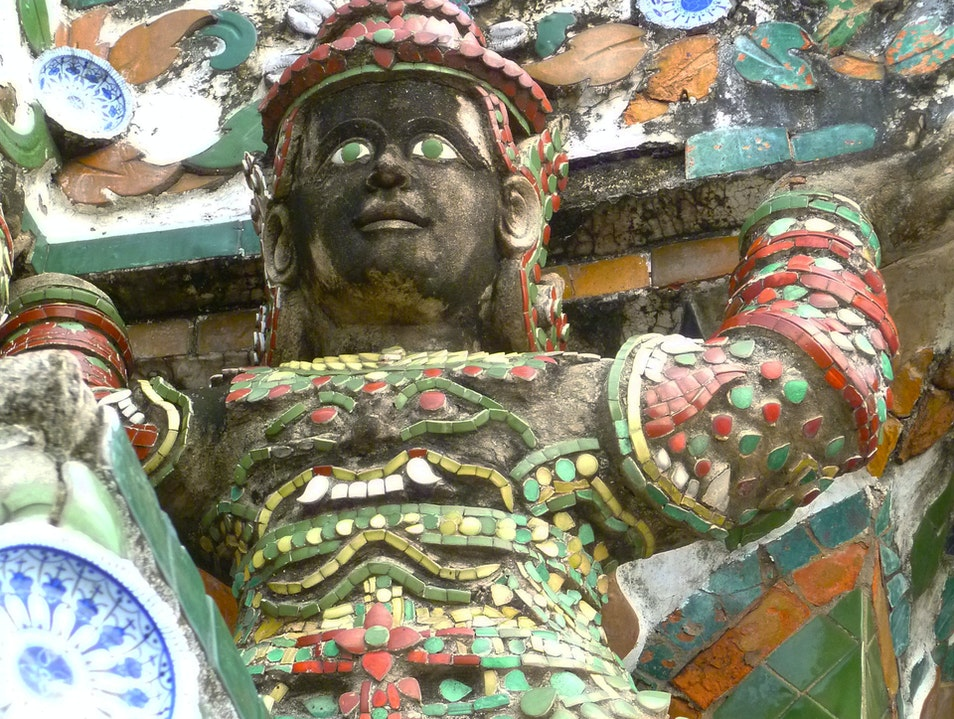 Green-Eyed Warrior Holding up the Tower Bangkok  Thailand
