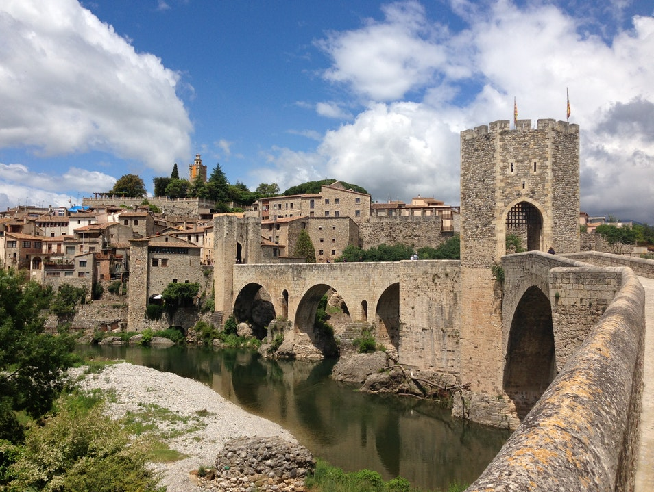 Stroll across an 11th century bridge into Besalú's medieval old town Besalú  Spain