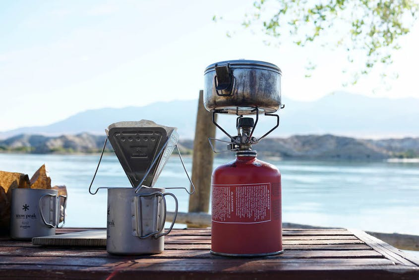 Snow Peak's gear, like their Ti-Double 450 Mug, GigaPower Stove, and Collapsible Coffee Drip (shown here), helps you brew fresh coffee anywhere.