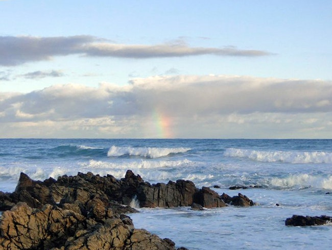 Rainbow at the Meeting Point of Oceans