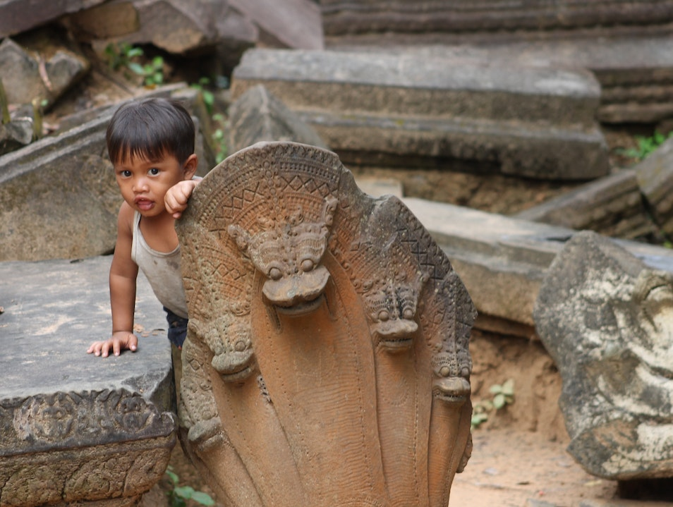 Play with local children in ancient ruins  Beng Mealea  Cambodia