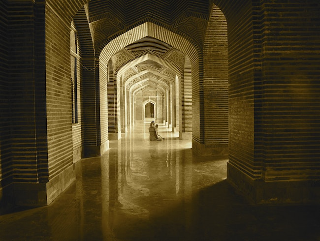 Woman praying in a mosque built by Emperor ShahJehan (Taj Mahal)