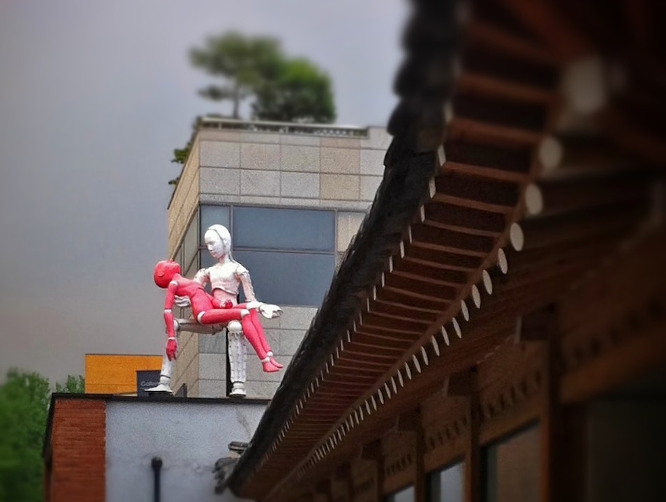 Unlikely art: crash-test-dummy Pietà on a rooftop