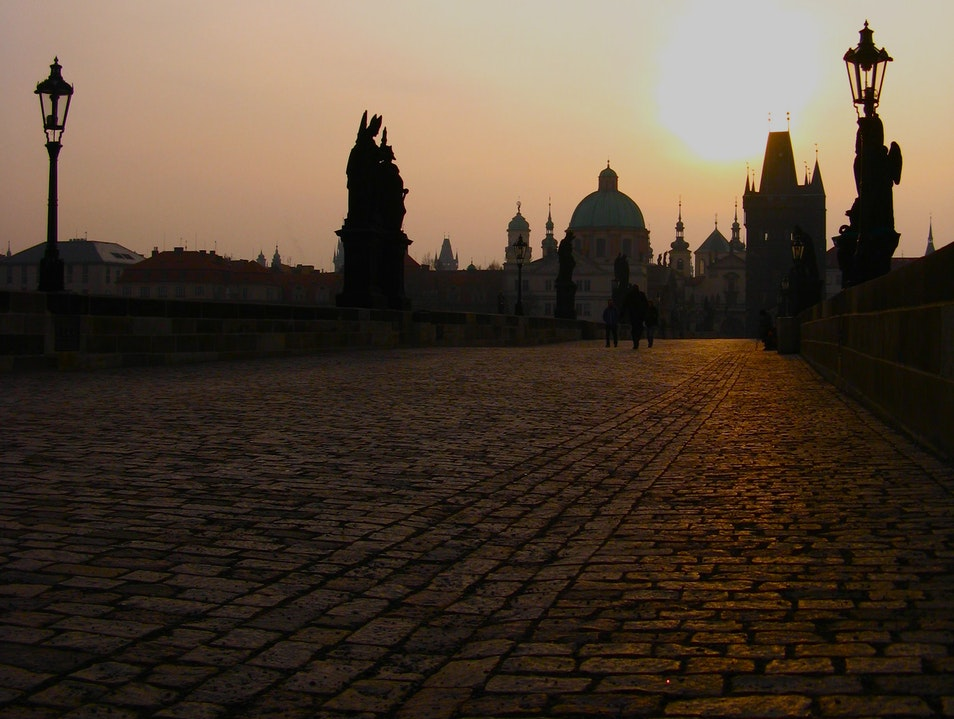 Watching the sun rise over the Charles Bridge Prague  Czechia