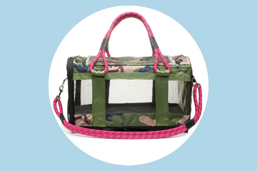 The Out of Office Pet Carrier comes in five colors, including the camouflage and magenta combination seen here.