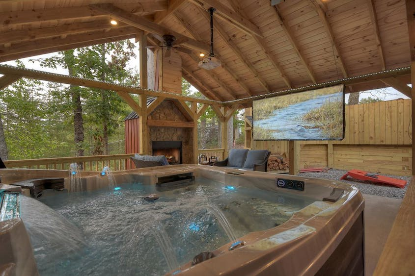 Watching movies while lounging in a hot tub? Sign us up.