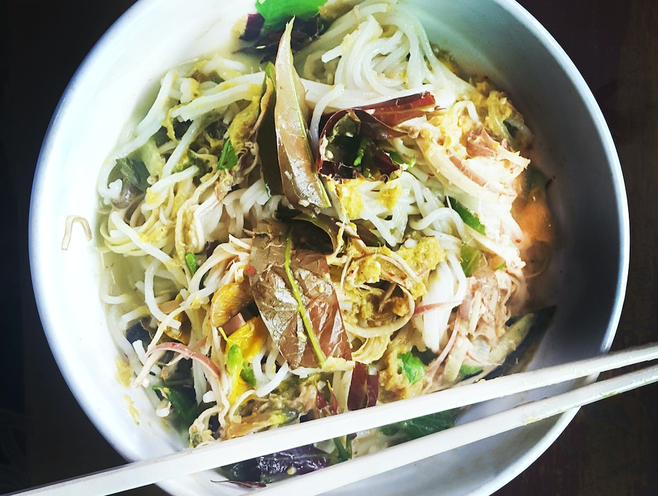 Breakfast on a cold bowl of Nom Banh Chok Siem Reap  Cambodia