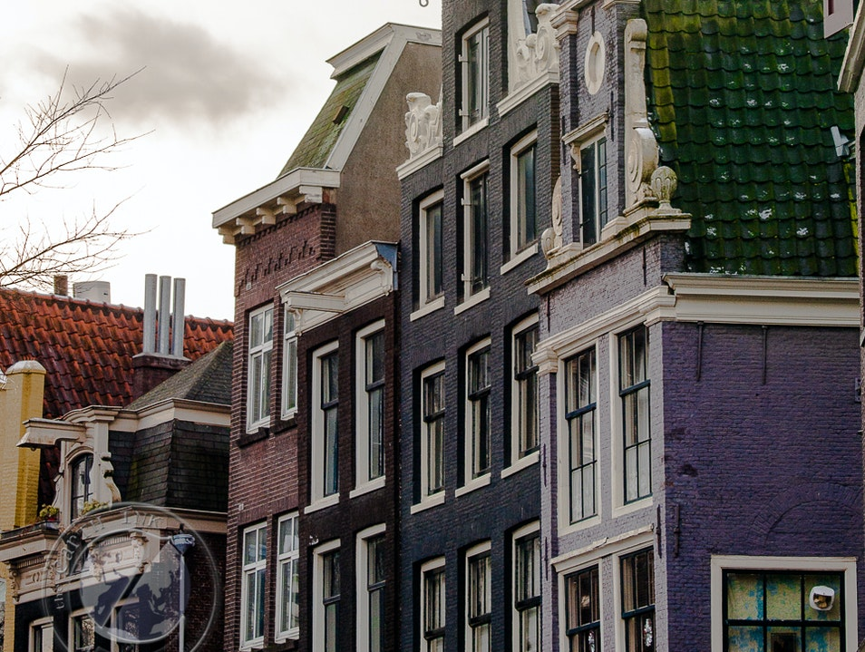 Over the Canals and Through the Dutch Facades Amsterdam  The Netherlands