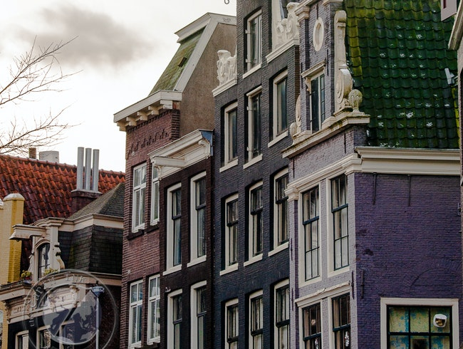 Over the Canals and Through the Dutch Facades