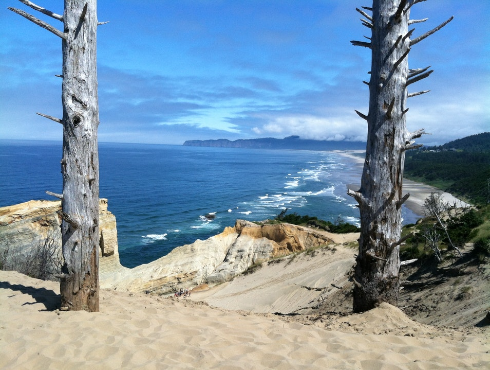 Climbing the sand dunes at Cape Kiwanda Pacific City Oregon United States
