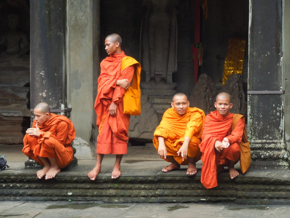 Colorful monks at the Citadel of Women Banteay Srei  Cambodia