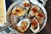 Devour Wood-Roasted Beach Oysters at Caracol