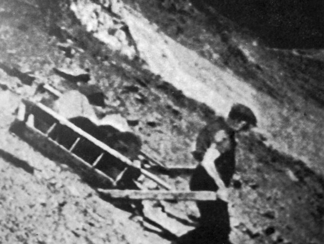 Sledging slate down screes at Honister Quarry
