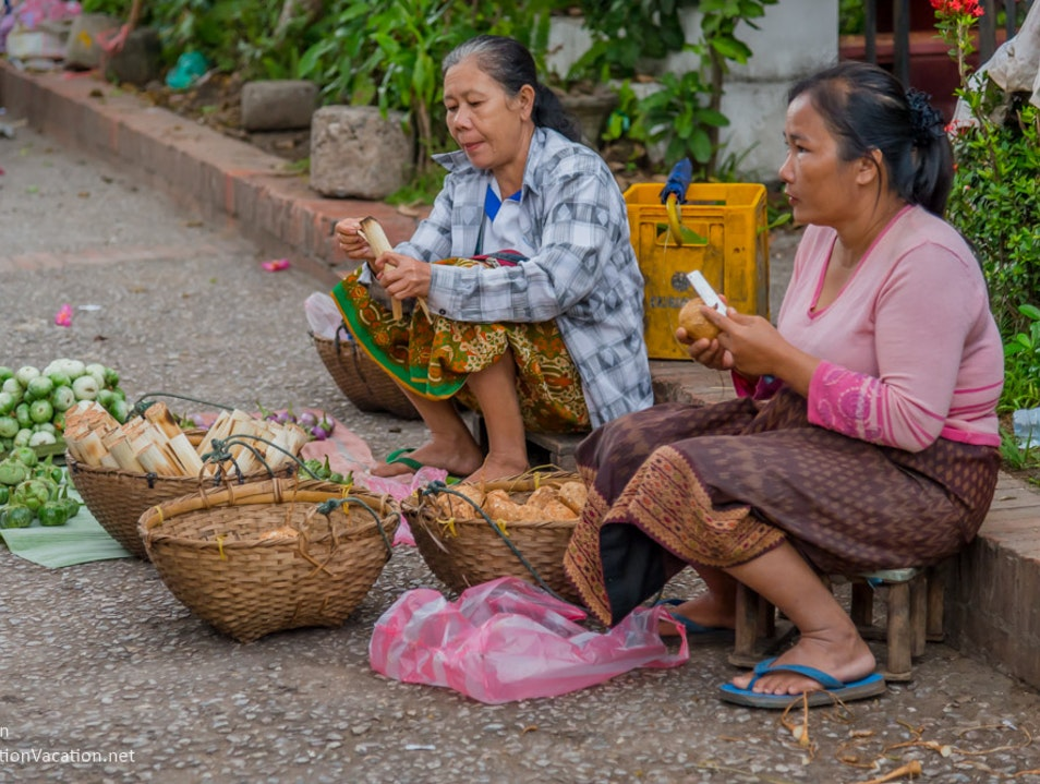 After the monks have moved on, head to the Luang Prabang morning market