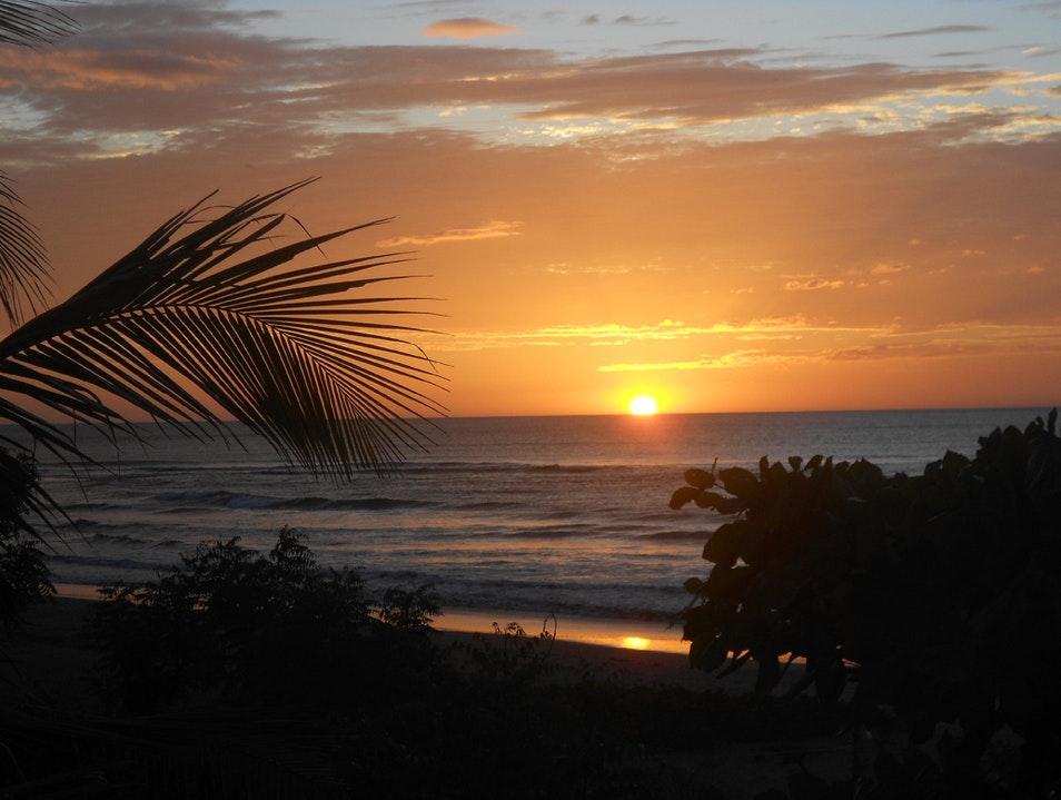 Watch the sunset on the quiet beach of Miramar Puerto Sandino  Nicaragua