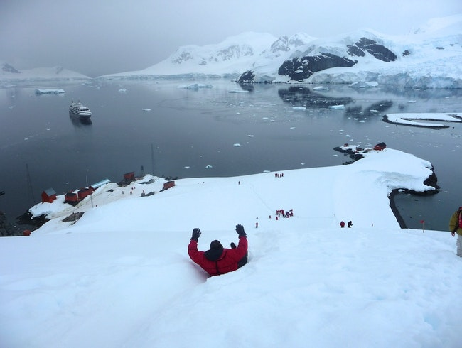 Bum-sledding in Antarctica
