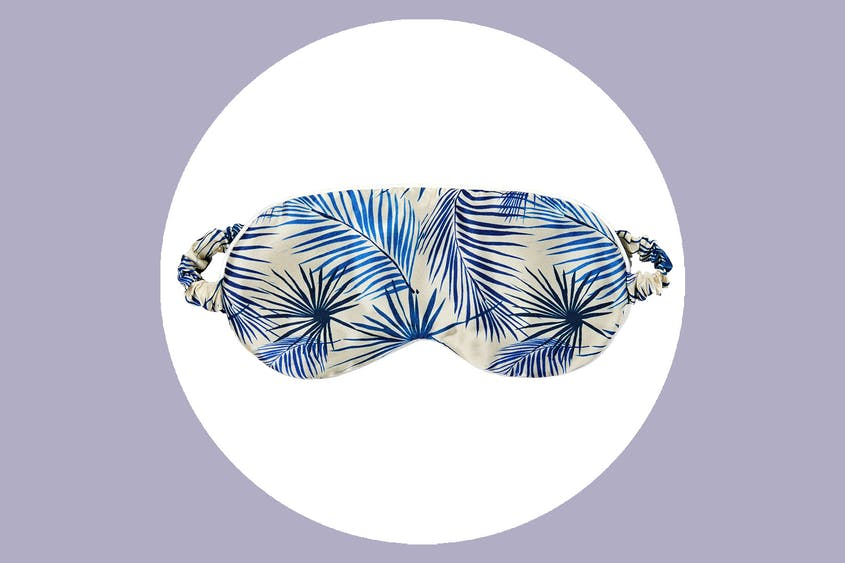 Start your vacation ASAP with this palm-printed sleep mask.