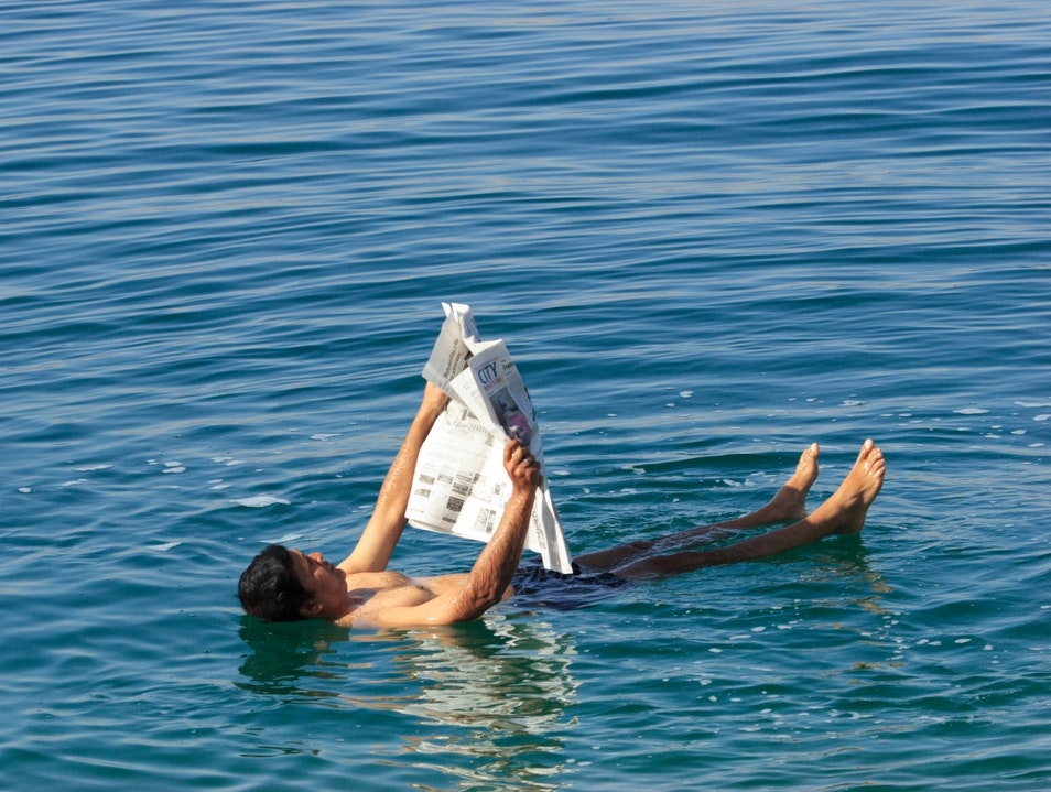 Recline and Read a Newspaper in the Dead Sea Karak  Jordan